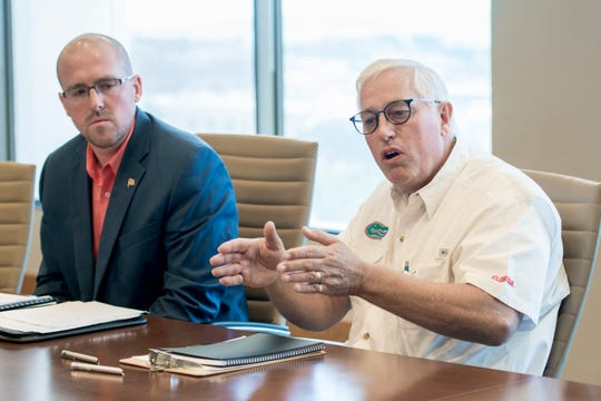 Florida Department of Transportation director of transportation development Jared Perdue, left, listens as Eisman & Russo Consulting Engineers program director Brett Pielstick talks about the cracks on the Pensacola Bay Bridge during a press conference in Pensacola on Tuesday, July 24, 2018.