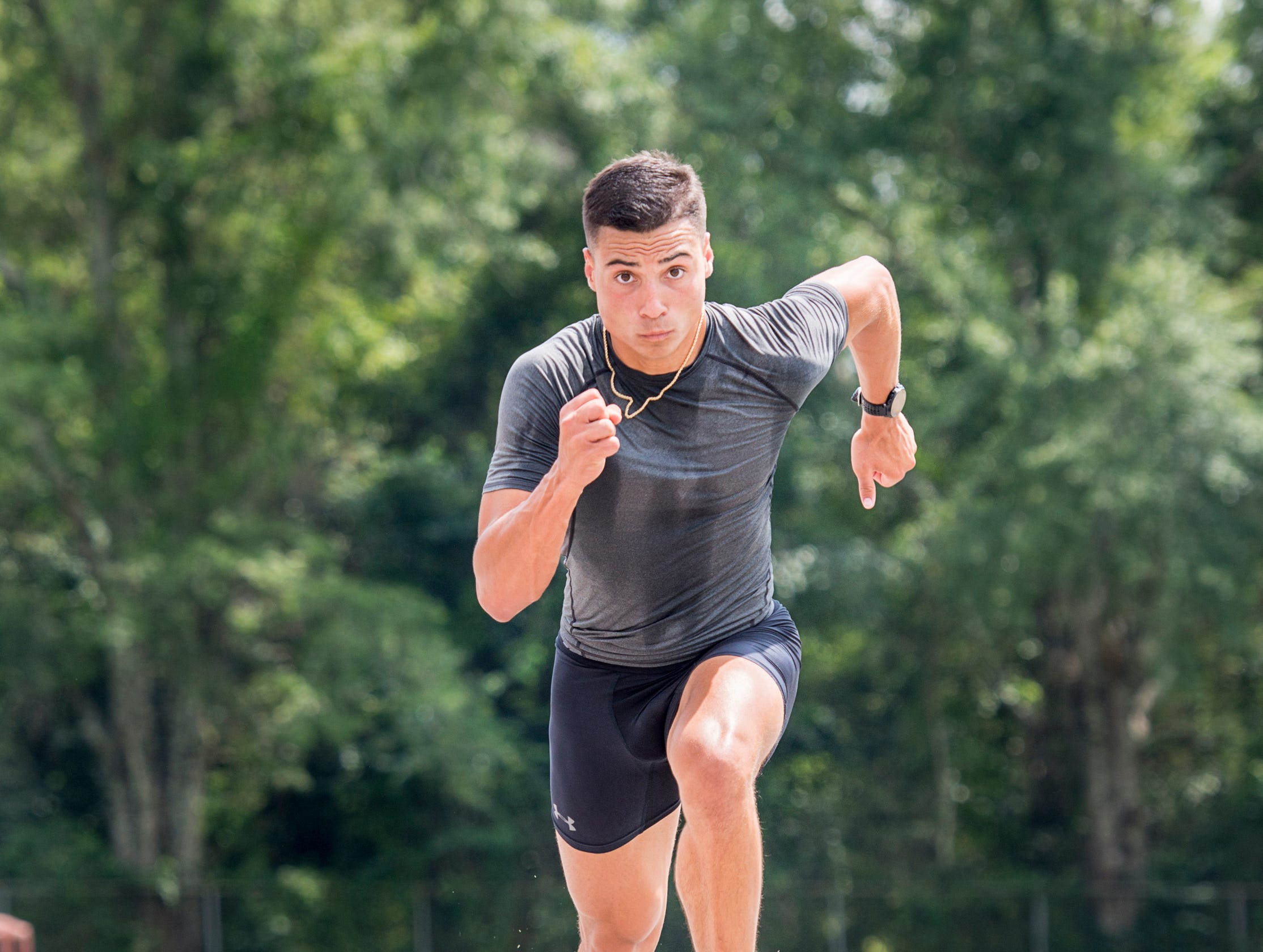 Decathlete Joseph Zayszly shows his running technique at Tate High School in Pensacola on Tuesday, July 24, 2018.