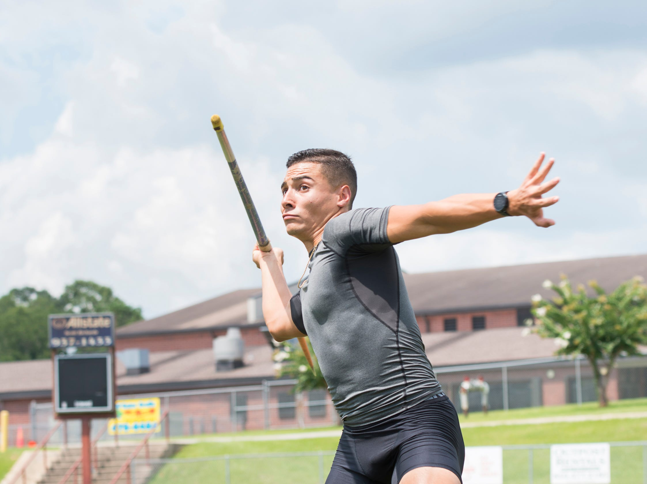 Decathlete Joseph Zayszly shows his javelin throwing technique at Tate High School in Pensacola on Tuesday, July 24, 2018.