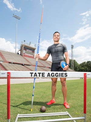 Track star Joseph Zayszly poses with some of the equipment that he uses to compete in the decathlon at Tate High School in Pensacola on Tuesday, July 24, 2018.