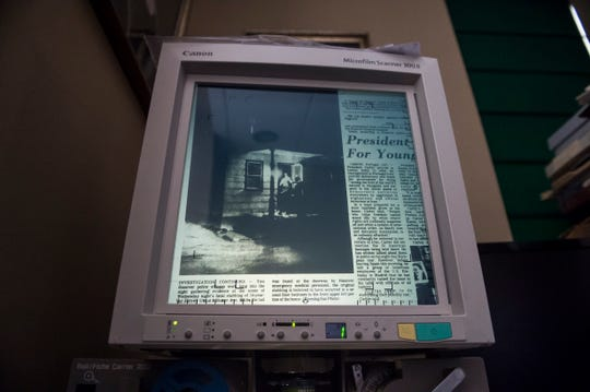 A microfilm scanner at Guthrie Memorial Library displays a copy of the June 26, 1980 edition of the Evening Sun. The photo shows the crime scene where Jeffrey Utz was killed.