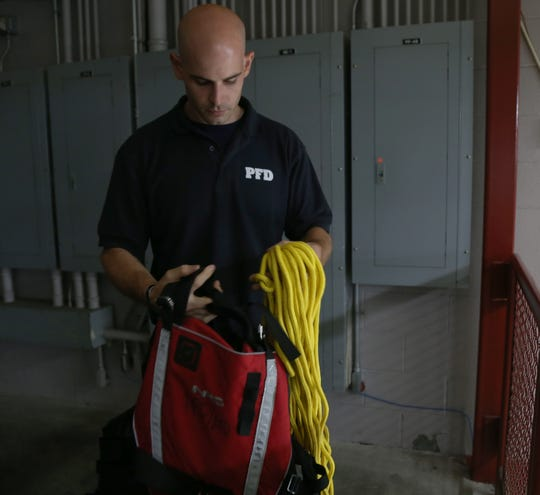 City of Poughkeepsie fireman Ken Deichler with his water rescue equipment at the Public Safety Building on July 24, 2018. Deichler was one of the first on the scene at Waryas park where a group of swimmers were reported having trouble. He is a six year veteran of the department.