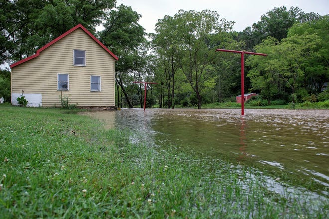 Water from the Pierceville Run floods the backyard of June Russell's Codorus Township home on Tuesday. Russell, who's lived in this house since 1967, said it's the worst it's been in a long time, comparing it to Tropical Storm Agnes in 1972.