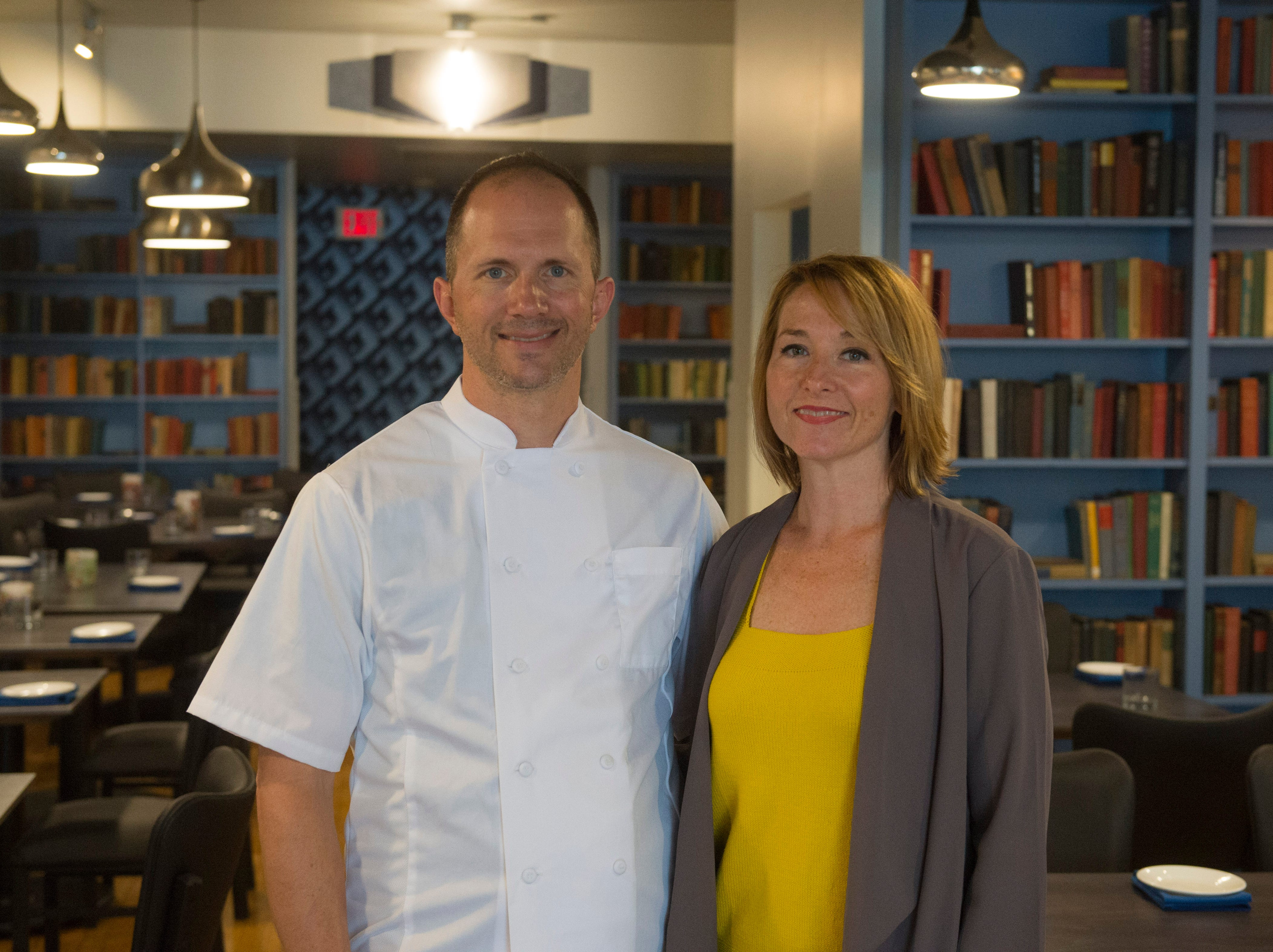 Owners of The Left Bank Sean and Mandy Arnold stand in the middle of the dining room that was renovated in July 2018.