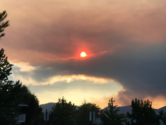 Smoke from the Carr Fire turns the sun red July 23, 2018 in north Redding.