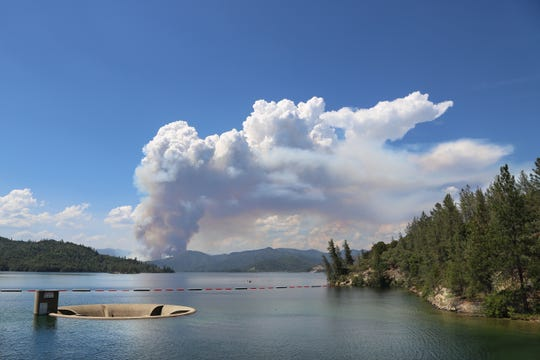 Smoke from the Carr Fire looms near Whiskeytown Lake's glory hole July 23, 2018.