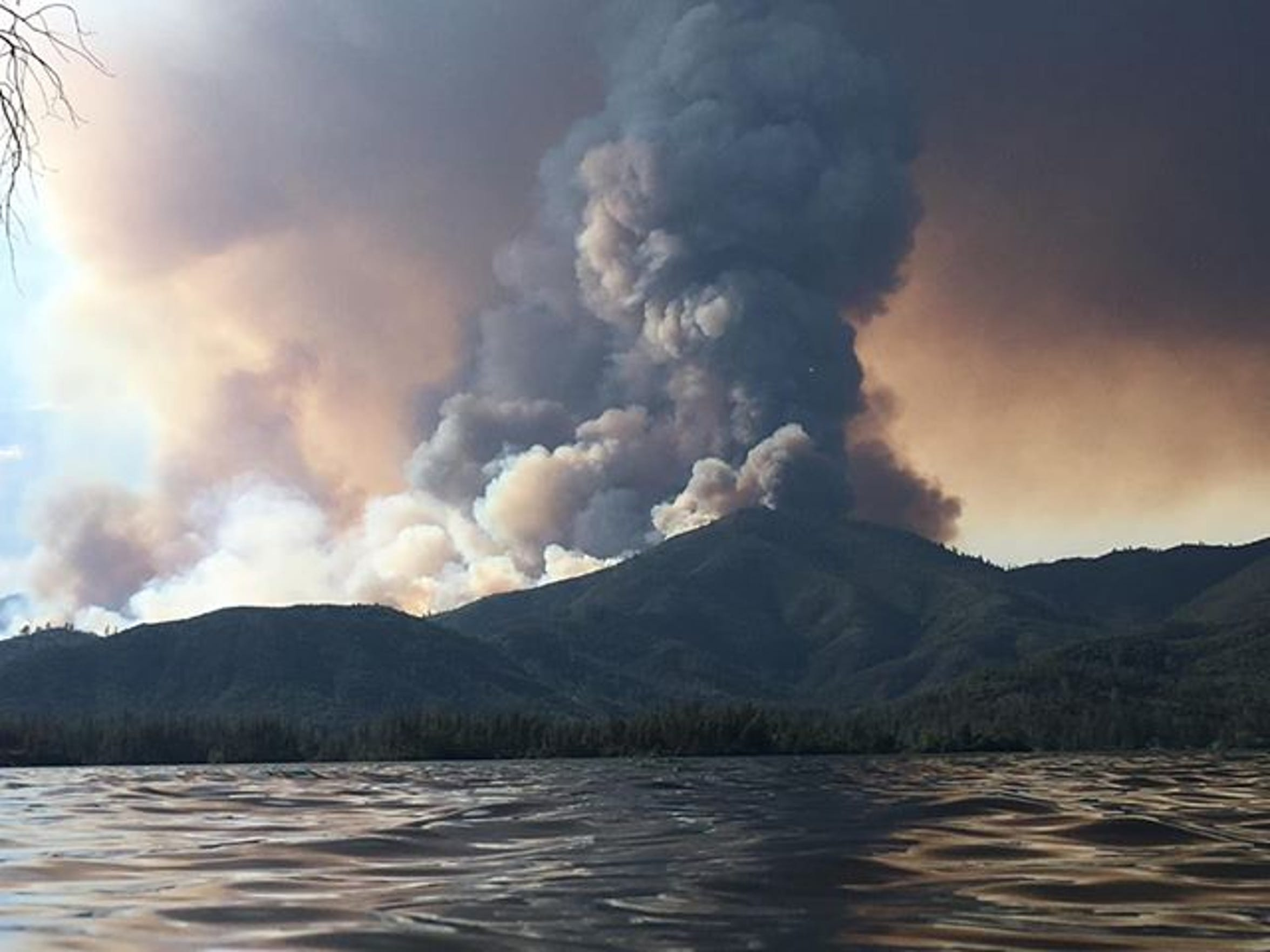 A plume of smoke rises from the Carr Fire on Monday, July 23, 2018, just north of Whiskeytown Lake in Shasta County.