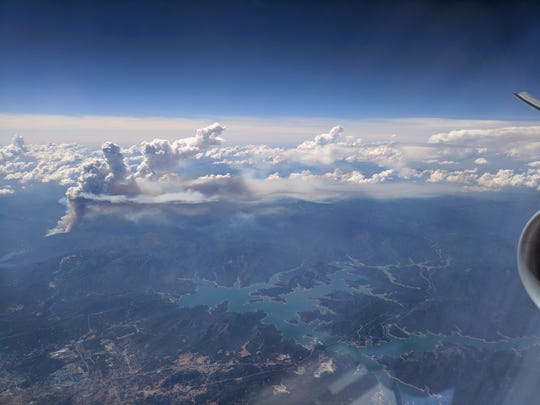 Smoke from the Carr Fire lingers in the sky July 23, 2018, as seen from a plane en route to San Francisco.
