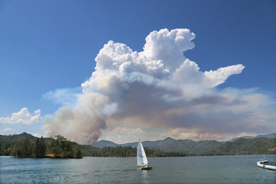 Smoke from the Carr Fire collects behind a sailboat on Whiskeytown Lake July 23, 2018,