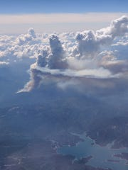 Smoke from the Carr Fire is scene from a plane en route to San Francisco in this July 23, 2018 contributed picture.