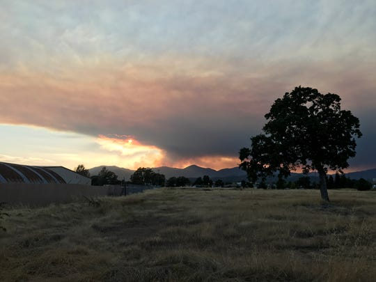 Smoke from the Carr Fire darkens the north Redding sky July 23, 2018.