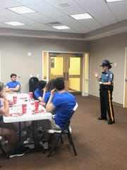 Delaware State Police Trooper Irina Celpan talks go a group of J-1 students.