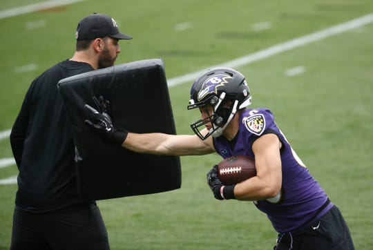 Baltimore Ravens wide receiver Jaelon Acklin runs a drill during an NFL football organized team activity at the team's headquarters in Owings Mills, Md., Thursday, May 31.