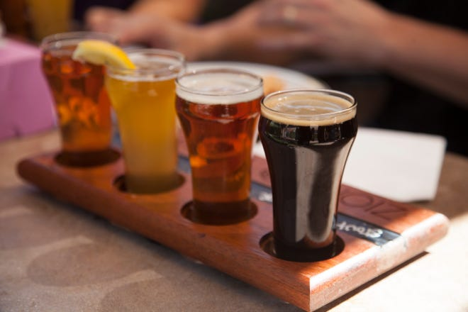 Beers are lined up during a tasting at Zion Brewery in Springdale on Monday, July 23, 2018