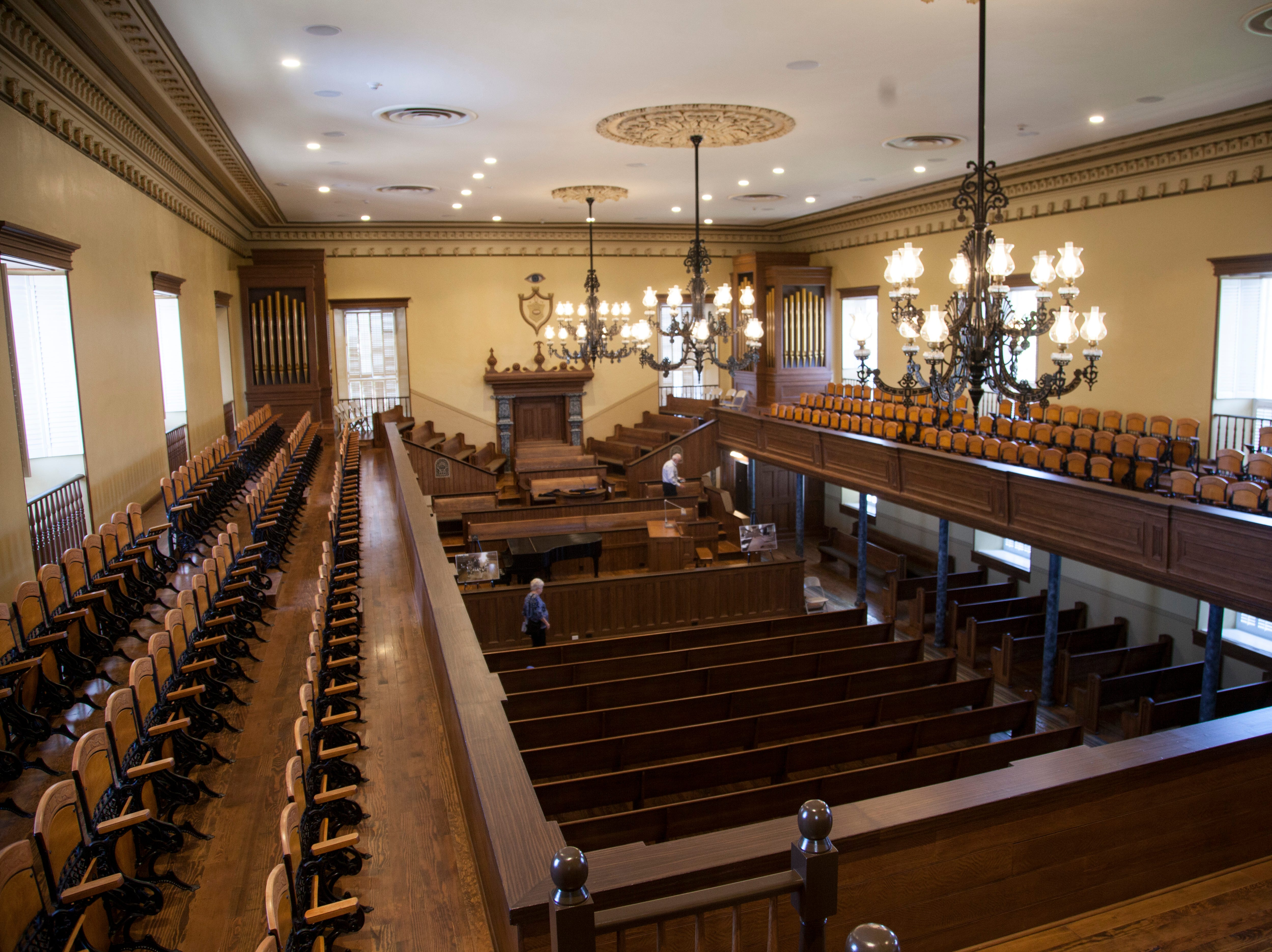 Community members tour the St. George Tabernacle after two years of renovations to preserve and secure the historic building Monday, July 23, 2018.