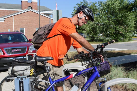 Jim Maucher prepares to ride his bicycle back to the small room he rents in a house in Dover. The 53-year-old recovering alcoholic said with the small amount of money he earns as a part-time handyman, living in a tiny house affordable housing village would be ideal.