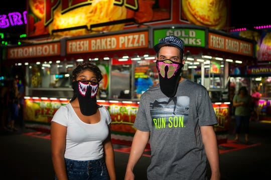 Two fairgoers wear face coverings at the 2018 state fair.
