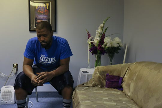 Henry Kee sits in the corner of an office at  Joshua Harvest Church while reflecting on the death of his stepson, Rashaad Wisher.