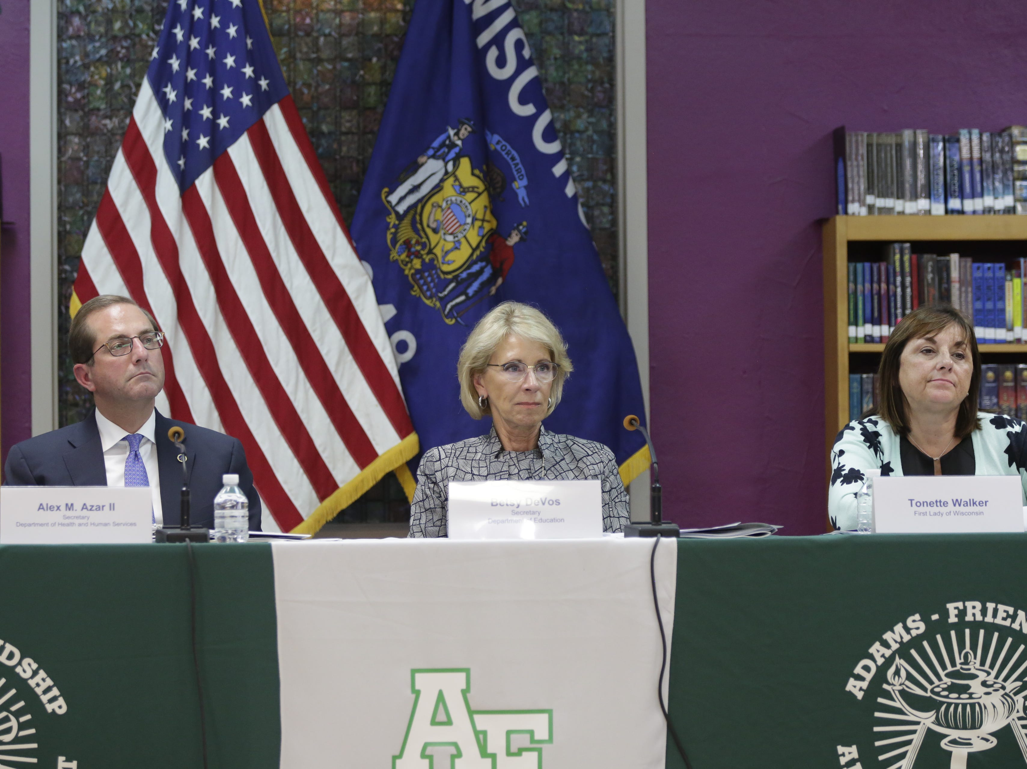 Alex Azar, Secretary of the Department of Health and Human Services, Betsy DeVos, U.S. Secretary of Education and Wisconsin first lady Tonette Walker, listen as a panel speaks to them at Adams-Friendship Middle School in Adams, Wis. Tuesday, July 24, 2018.