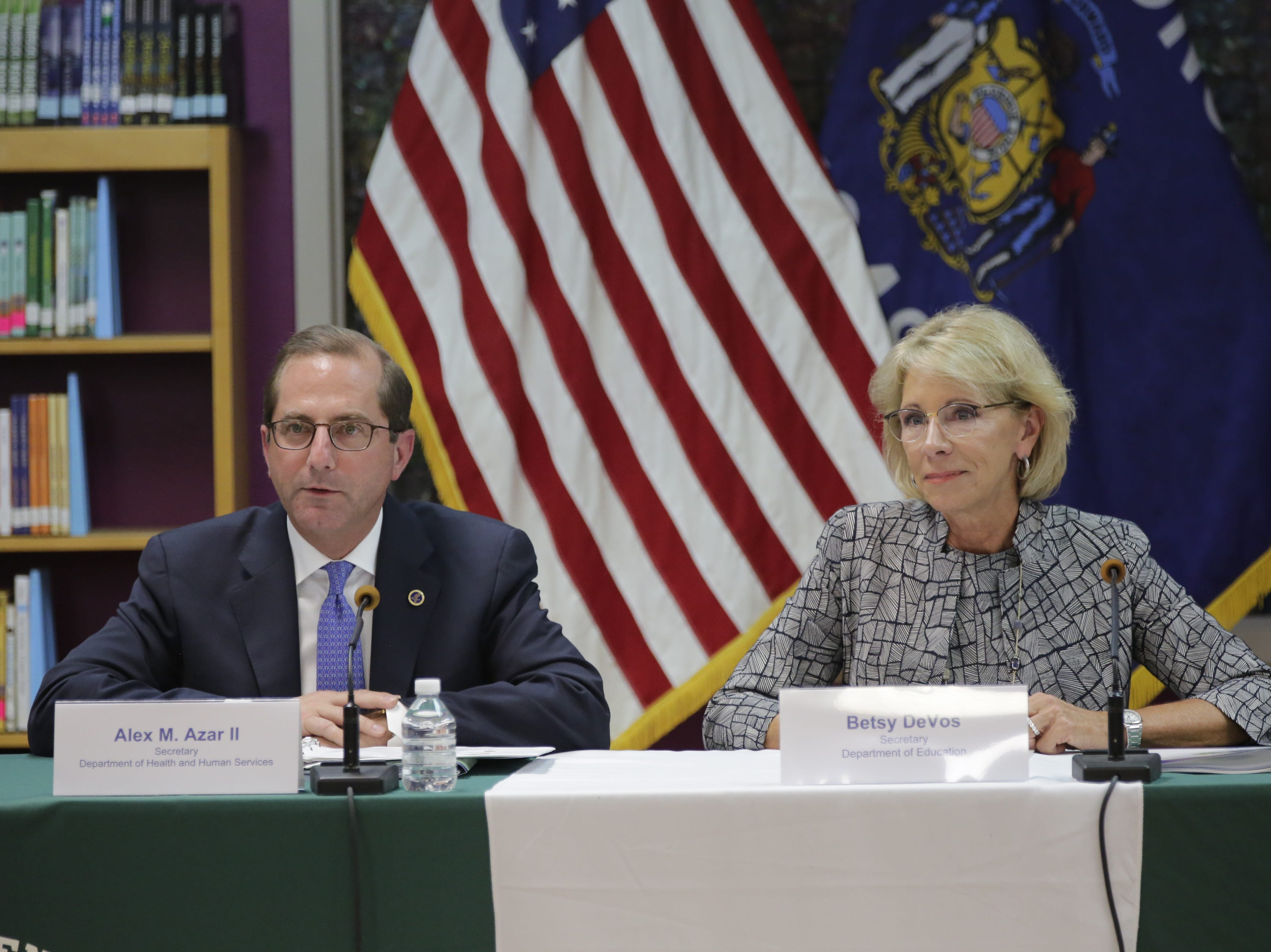 Secretary of the Department of Health and Human Services Alex Azar speaks alongside U.S. Secretary of Education Betsy DeVos at Adams-Friendship Middle School in Adams, Wis. Tuesday, July 24, 2018.