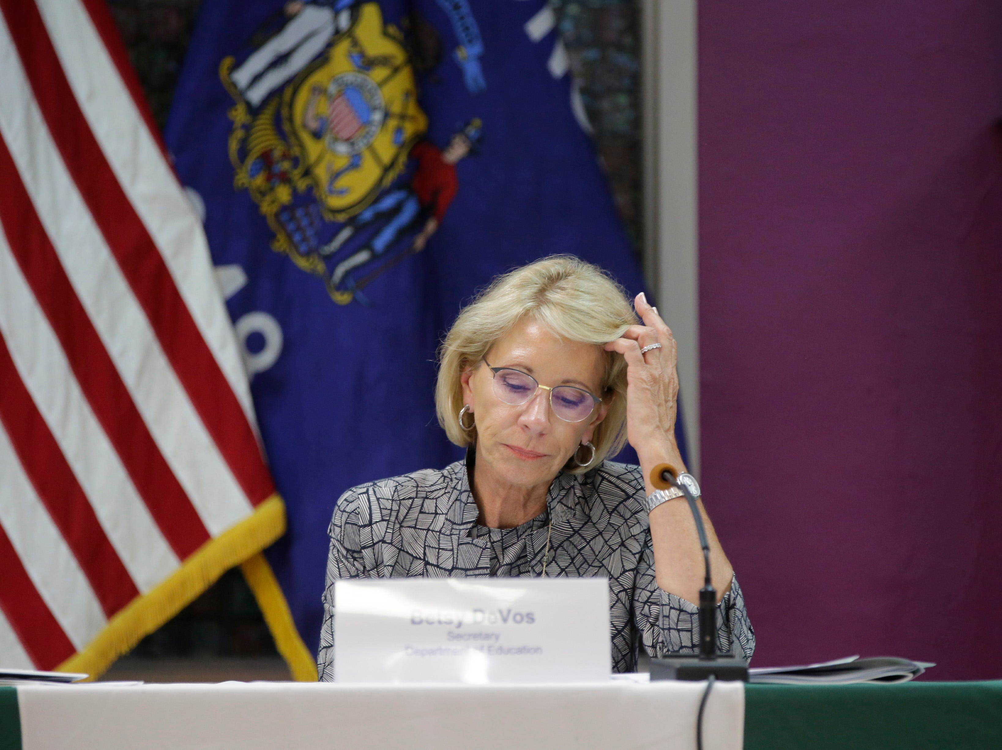 U.S. Secretary of Education Betsy DeVos takes notes as a panel speaks with her at Adams-Friendship Middle School in Adams, Wis. Tuesday, July 24, 2018.