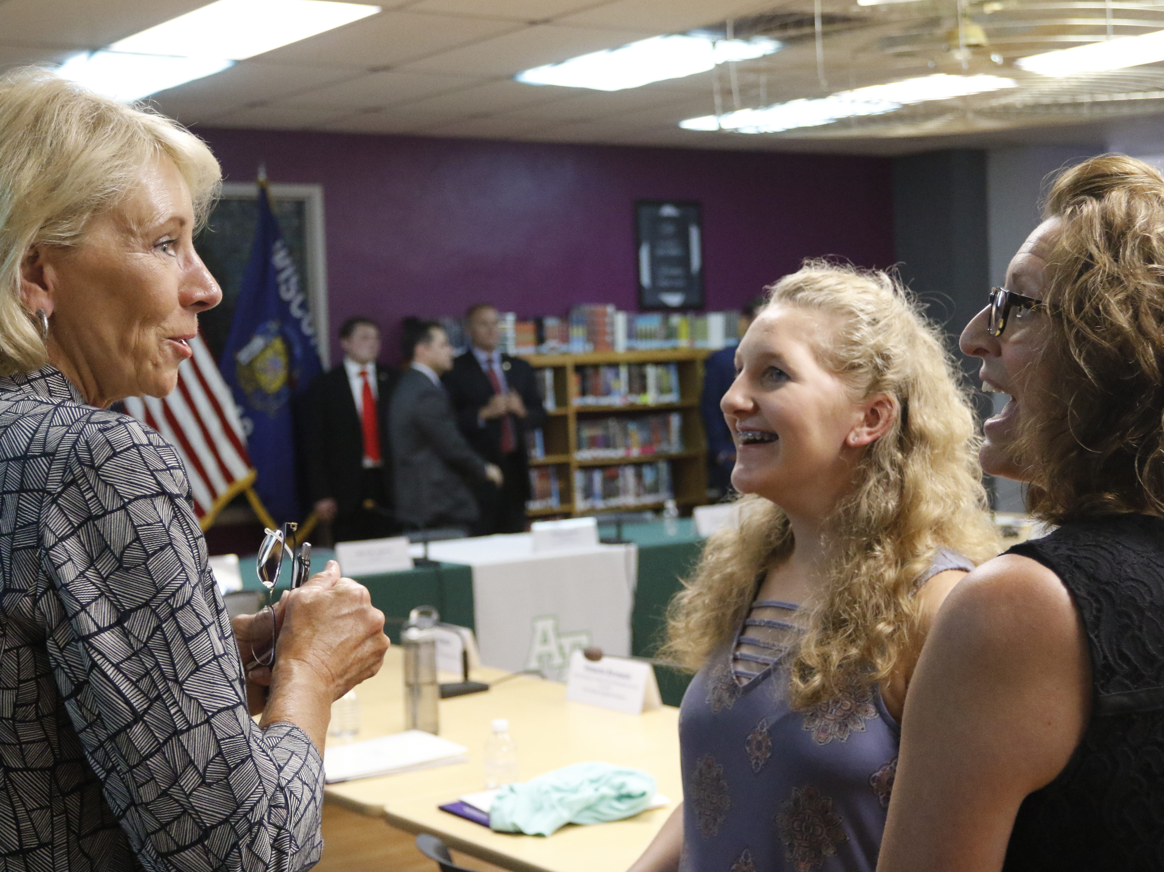 U.S. Secretary of Education Betsy DeVos talks with Tristan Kotlowski, a student, center and her mother Janet Kotlowski, an Adams-Friendship School District teacher at Adams-Friendship Middle School in Adams, Wis. Tuesday, July 24, 2018.