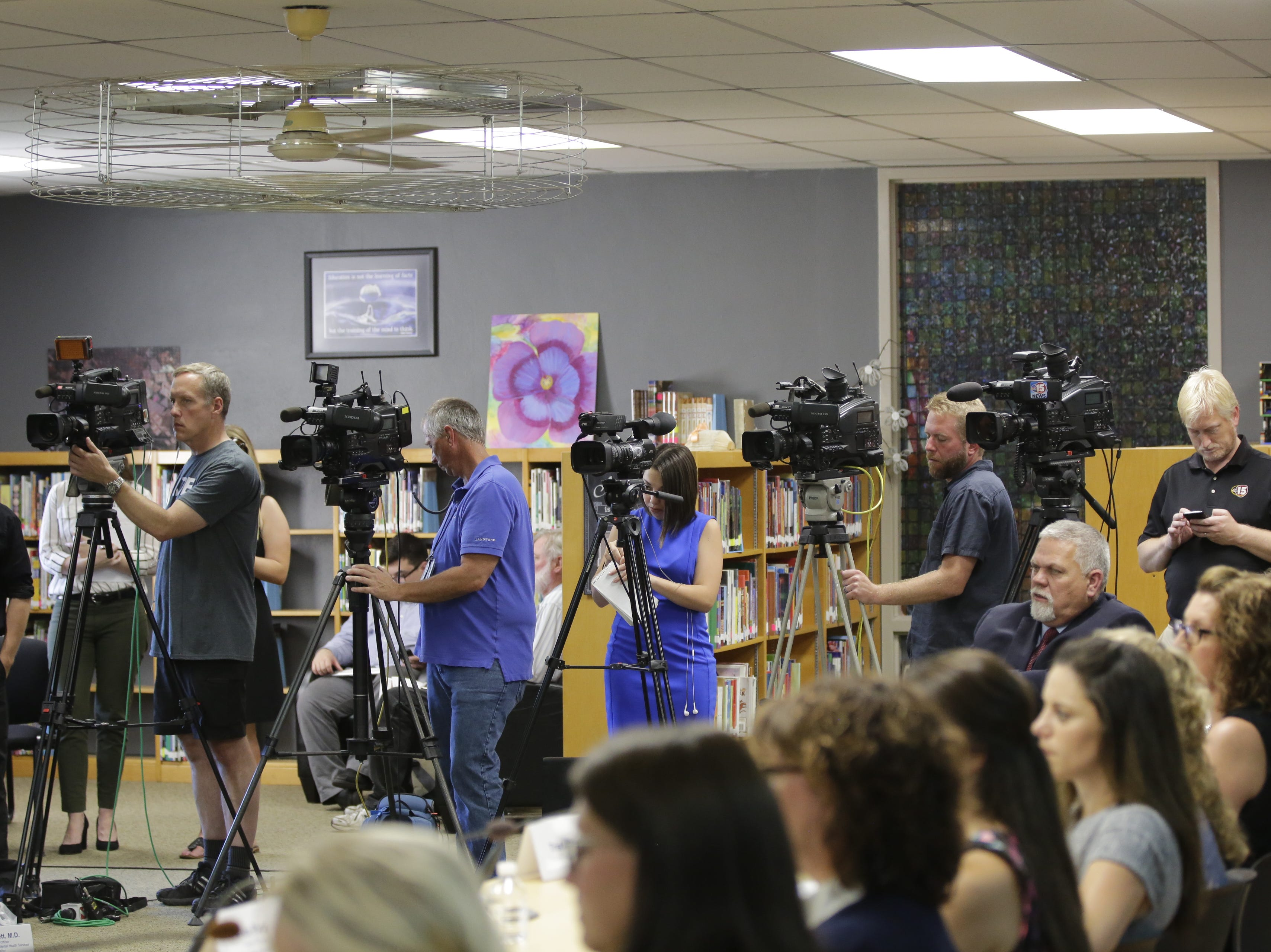 TV cameras are set up at Adams-Friendship Middle School in Adams, Wis. as U.S. Secretary of Education Betsy DeVos appears in the school's library Tuesday, July 24, 2018.