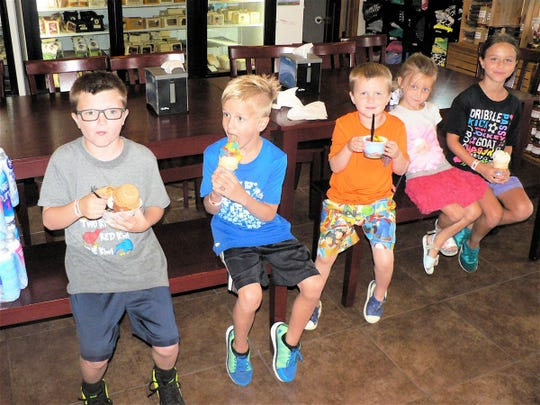 Little people like these from two families and their mothers in Sun Prairie and Columbus love the ice cream.