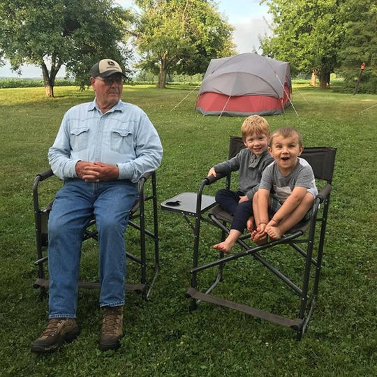 Grandpa Bob with Harrison and Wyatt wondering — Is it time for S'mores yet?