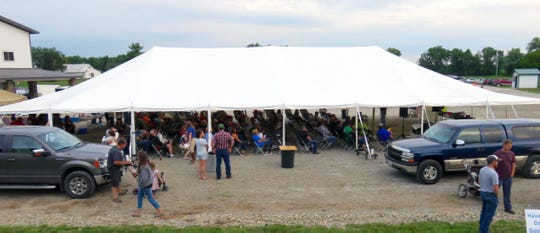 The 400-plus Dairy at Dusk attendees gathered under the big test for food and entertainment.