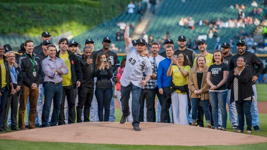 Former Ragin' Cajun Danny Farquhar throws out the first pitch before a Chicago White Sox game several weeks after suffering a brain hemorrhage during a 2018 game.