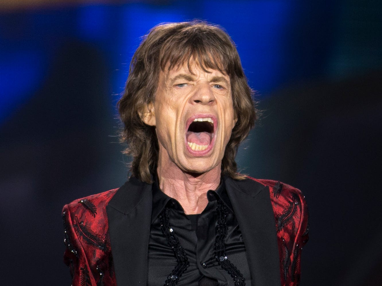 Singer Mick Jagger of British band, the Rolling Stones,  reacts as they perform,  at Real Madrid's Santiago Bernabeu soccer stadium, in Madrid, Spain, Wednesday June 25, 2014 as part of the '14 On Fire' tour. The Madrid concert is the band's only date in Spain. (AP Photo/Paul White)