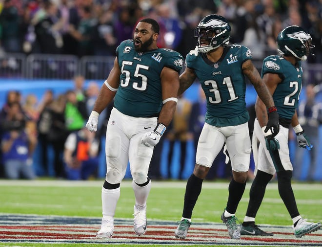 Philadelphia Eagles defensive end Brandon Graham (55) celebrates after causing a fumble against the New England Patriots receiver in the fourth quarter in Super Bowl LII at U.S. Bank Stadium.