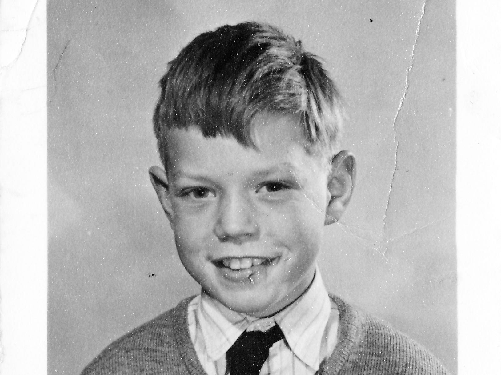 DARTFORD,UNITED KINGDOM -  CIRCA 1951: (EMBARGOED FOR PRINT USAGE UNTIL THURSDAY JULY 2ND 2015)  A school photo of a 9 year old Mick Jagger (1951) at Wentworth Junior County Primary School in his home town  Dartford. This previously unseen image will form part of The Rolling Stones - 'Exhibitionism' at Londons Saatchi Gallery. Mick Jagger, Keith Richards, Charlie Watts and Ronnie Wood have opened their personal archives and found never before seen photographs of themselves as youngsters. These along with hundreds more rare and unseen images will create the first ever international Rolling Stones exhibition which will open at the Saatchi Gallery in April 2016. (Photo by Stones Archive/Getty Images) ORG XMIT: 561825389 ORIG FILE ID: 479111158