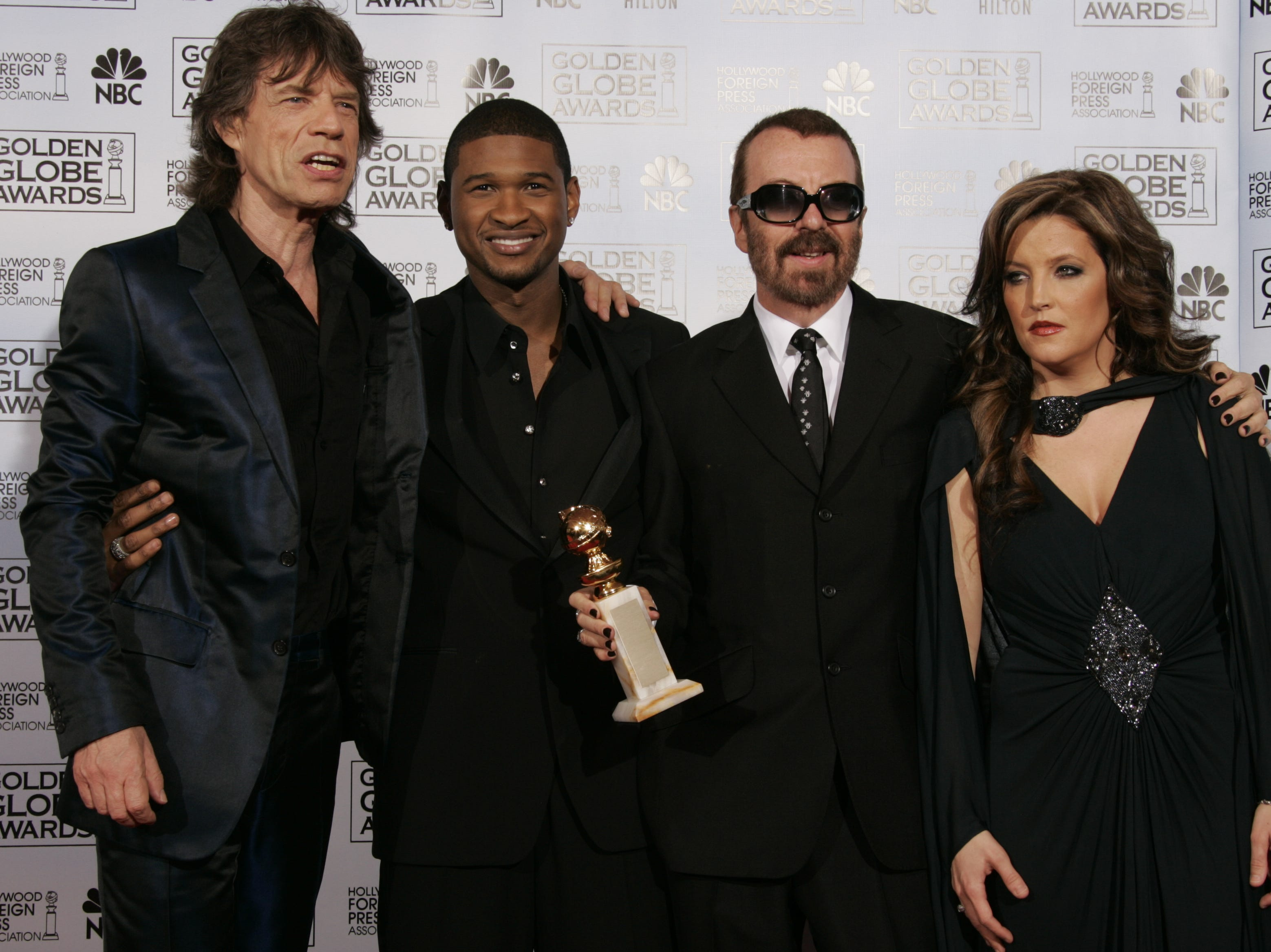 1/16/2005: Golden Globe Awards -- Beverly Hills, CA -- Mick Jagger, Dave Stewart, Usher and Lisa Marie Presley in the photo room at the Golden Globe Awards. (photo by Robert Hanashiro, USA TODAY) (Via MerlinFTP Drop)