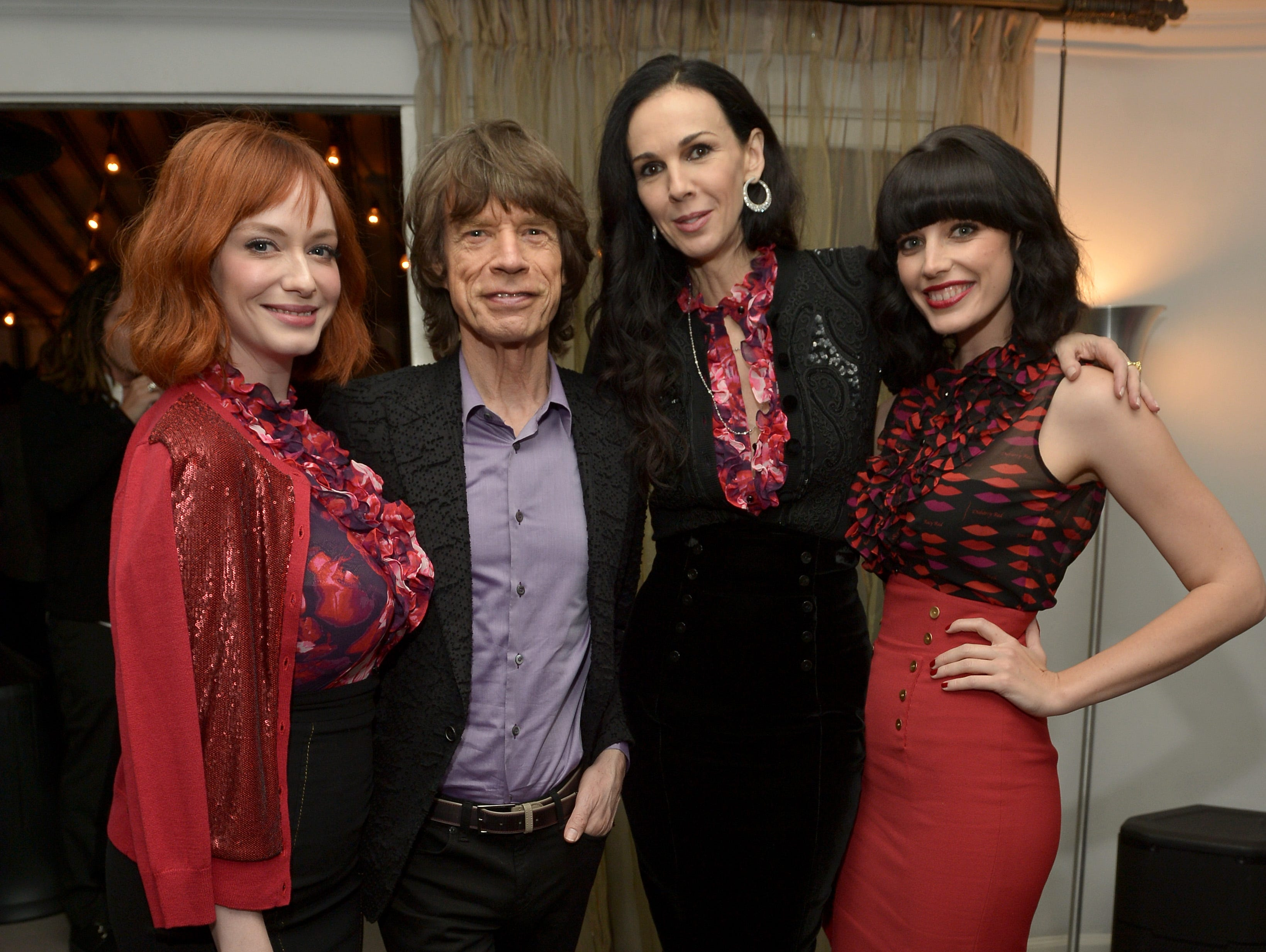 LOS ANGELES, CA - NOVEMBER 19:  (L-R) Actress Christina Hendricks, singer Mick Jagger, fashion designer L'Wren Scott, and actress Jessica Pare attend the launch celebration of the Banana Republic L'Wren Scott Collection hosted by Banana Republic, L'Wren Scott and Krista Smith at Chateau Marmont on November 19, 2013 in Los Angeles, California.  (Photo by Charley Gallay/Getty Images for Banana Republic) ORG XMIT: 187206345 ORIG FILE ID: 450681199