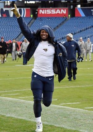 Los Angeles Rams running back Todd Gurley II (30) runs off the field after a win against the Tennessee Titans at Nissan Stadium.