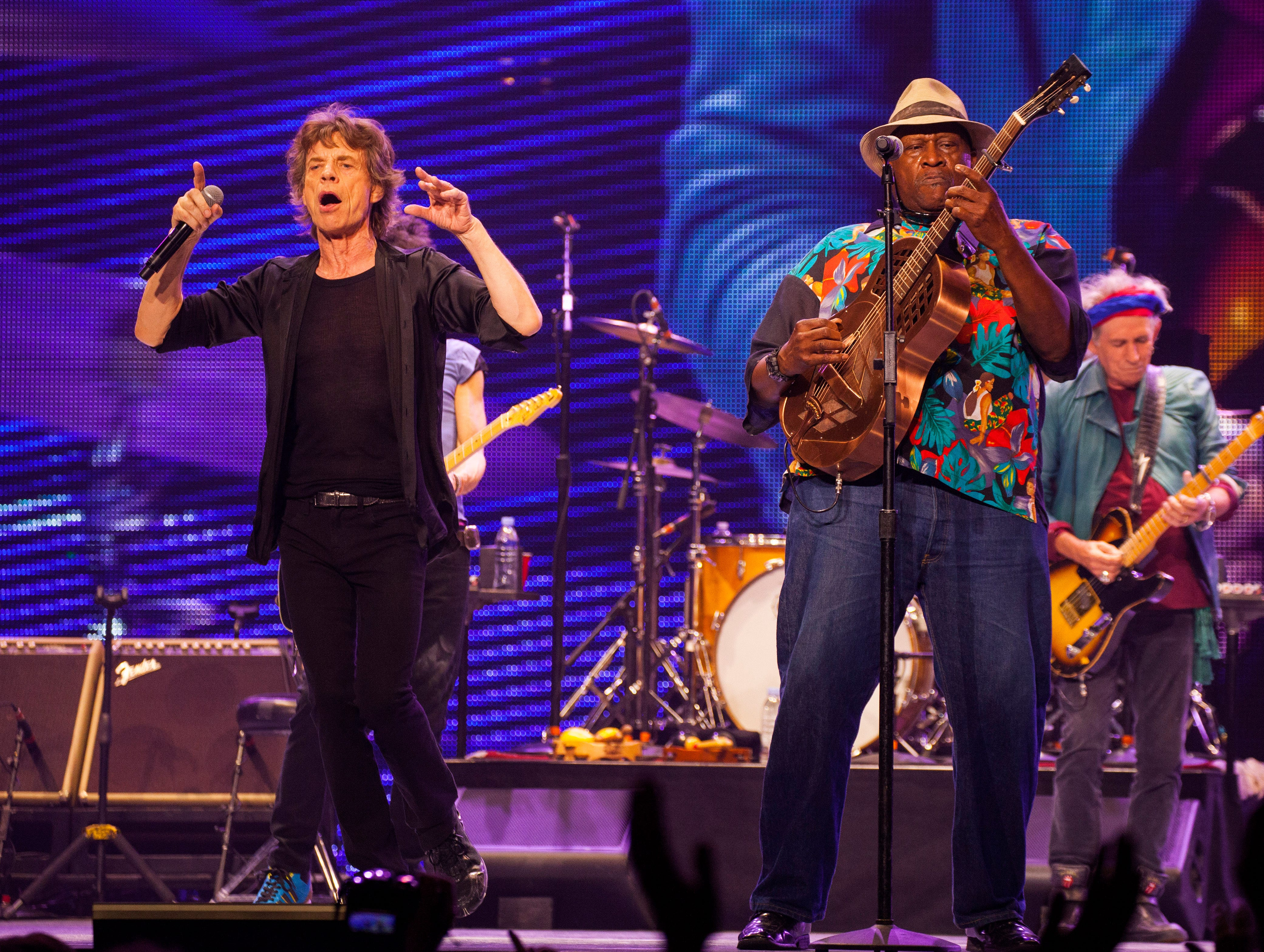 Mick Jagger, left, and Keith Richards, right, of the Rolling Stones, perform with special guest Taj Mahal at the United Center on Tuesday, May 28, 2013 in Chicago. (Photo by Barry Brecheisen/Invision/AP) ORG XMIT: ILBB107