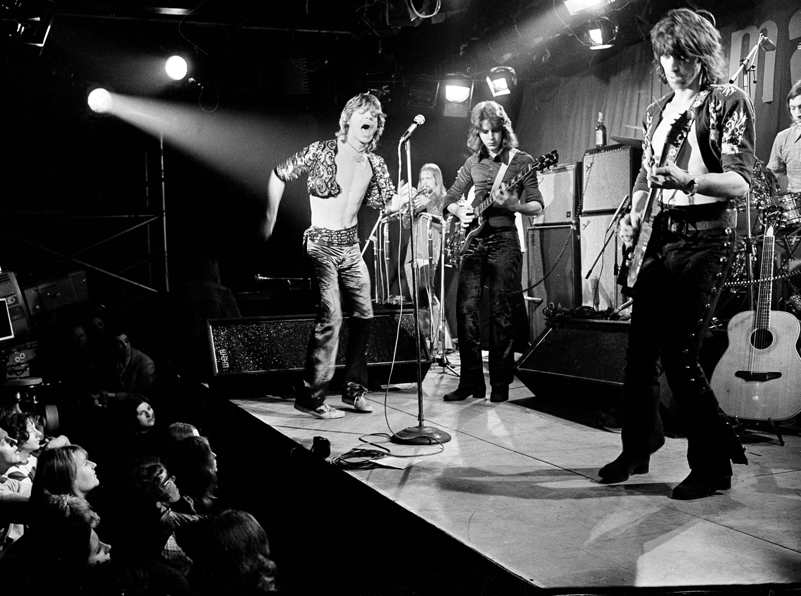 ORG XMIT: NYET168 FILE - This March 26, 1971 file photo shows British rock and roll band The Rolling Stones during their farewell performance at London's Marquee Club, in London.  The band members are, from left, Mick Jagger, vocals; Mick Taylor, guitar; Keith Richards, guitar; and Charlie Watts, drums. The musician in background is unidentified. Thursday, July 12, 2012, marks 50 years since Jagger played his first gig with the band. Now in their late 60s and early 70s, the band members are celebrating the anniversary by attending a retrospective photo exhibition at London's Somerset House _ and looking to the future by rehearsing for new gigs. (AP Photo, file)