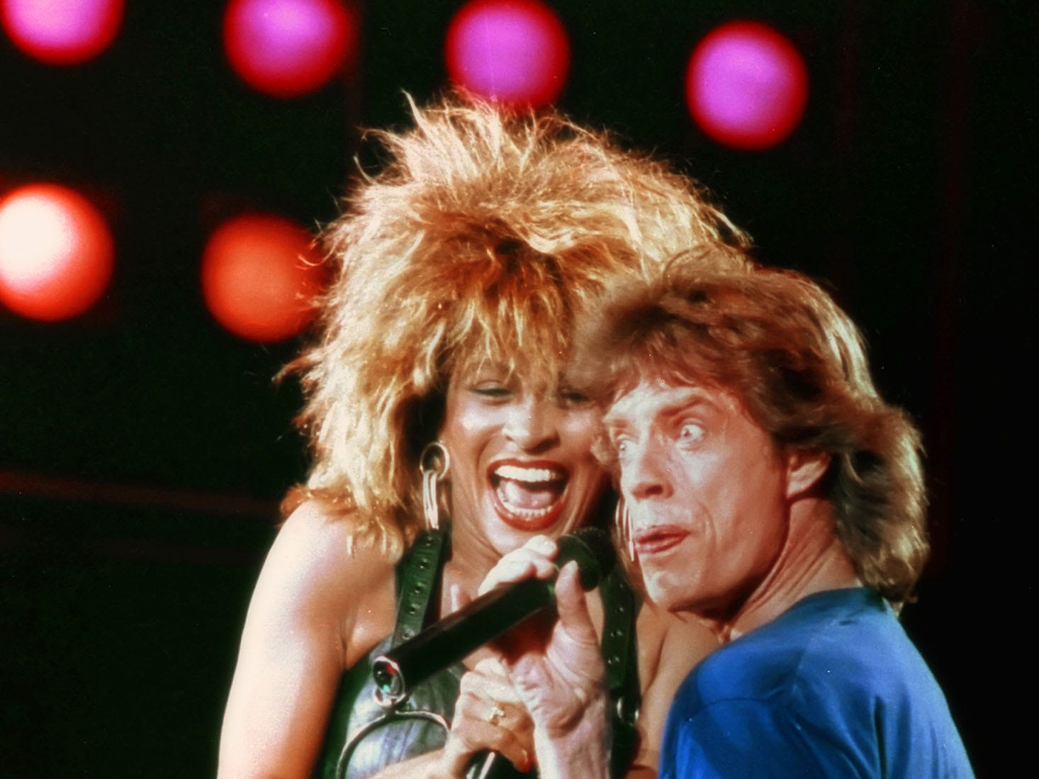 Tina Turner, left, reacts as  Mick Jagger grabs her thigh during their duo performance at the Live Aid concert in Philadelphia, Pa., July 13, 1985.  (AP Photo/Amy Sancetta) ORG XMIT: APHS199 [Via MerlinFTP Drop]