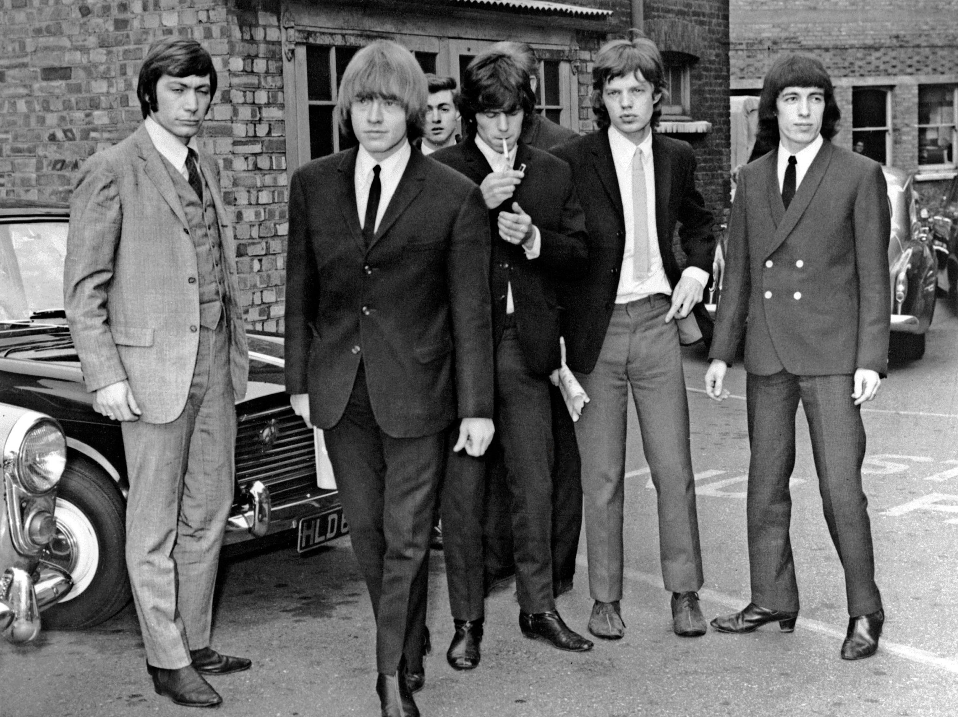 TO GO WITH AFP STORY BY JAMES PHEBY (FILES) A file picture taken in London, on July 22, 1965, shows members of the Rolling Stones band (L-R) Charlie Watts, Brian Jones, Keith Richards, Mick Jagger and Bill Wyman. Most London shoppers rush by 165 Oxford Street without a second glance -- but it was here 50 years ago that The Rolling Stones played their first gig and changed the landscape of pop music forever. Mick Jagger, Keith Richards and Brian Jones played The Marquee Club on July 12, 1962 with three others, the first time they performed under the band name which would become synomymous worldwide with excess and muscial flair.  AFP PHOTO /FILES-/AFP/GettyImages ORIG FILE ID: 512206079