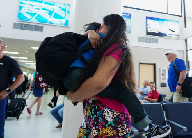 Twenty-four-year-old Dunia of Honduras embraces her 5-year-old son Wuilman at Brownsville South Padre Island International Airport in Brownsville, Texas, on July 20, 2018, as they were reunited after being separated from each other for more than 30 days.