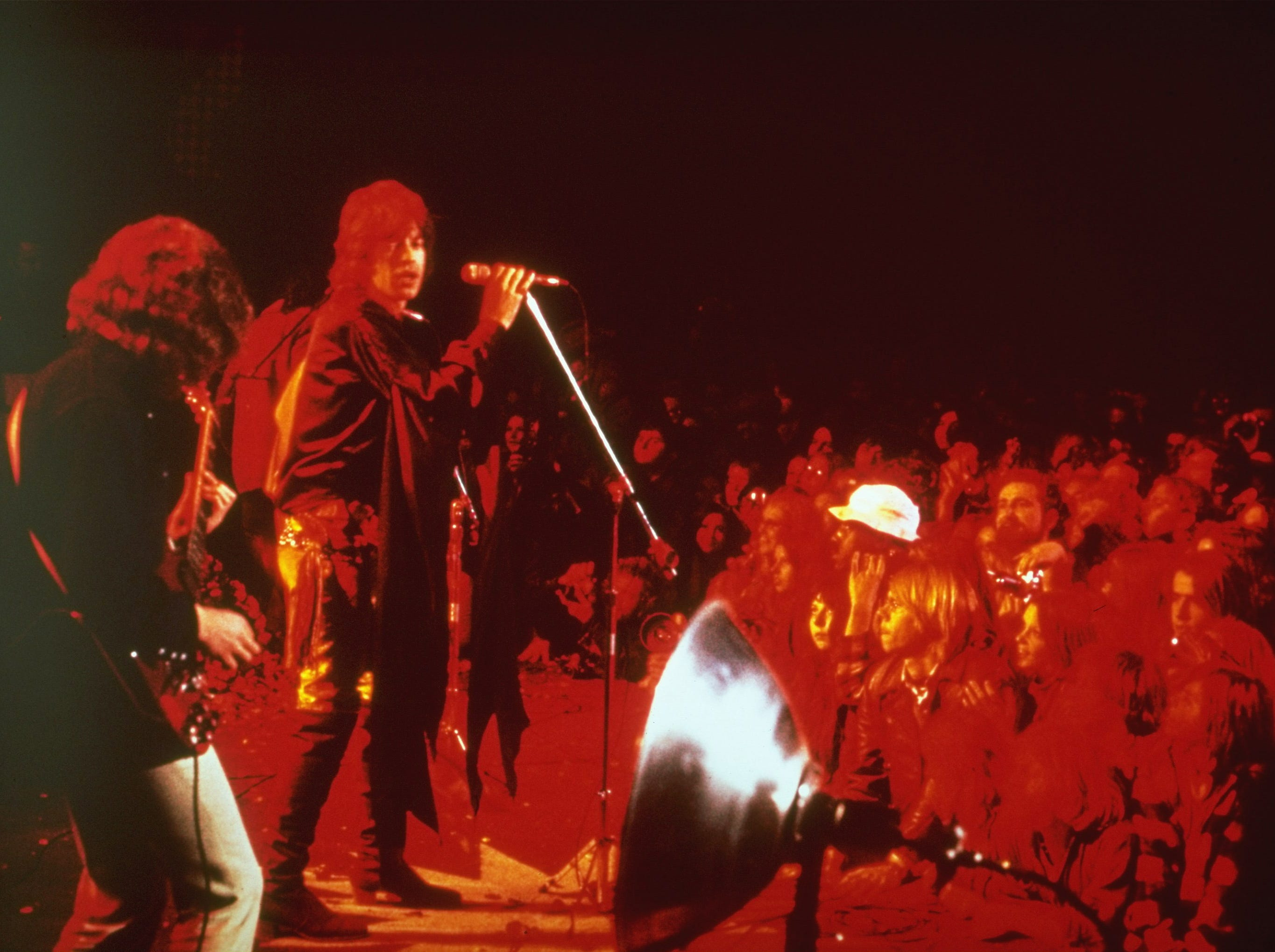 "This is the infamous ""Gimme Shelter"" rock concert featuring the Rolling Stones at the Altamont Race Track in California on December 8, 1969. Lead singer Mick Jagger and guitarist Mick Taylor are on stage. A fan was stabbed to death at the show by a member of the Hells Angels motorcycle club. (AP Photo)"