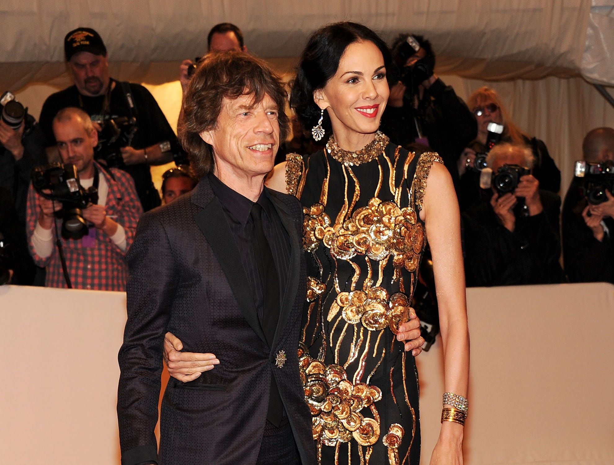 "(FILE PHOTO) NEW YORK, NY - MAY 02:  Musician Mick Jagger and Designer L'Wren Scott attend the ""Alexander McQueen: Savage Beauty"" Costume Institute Gala at The Metropolitan Museum of Art on May 2, 2011 in New York City.  (Photo by Larry Busacca/Getty Images) ORG XMIT: 479617943 ORIG FILE ID: 113517434"