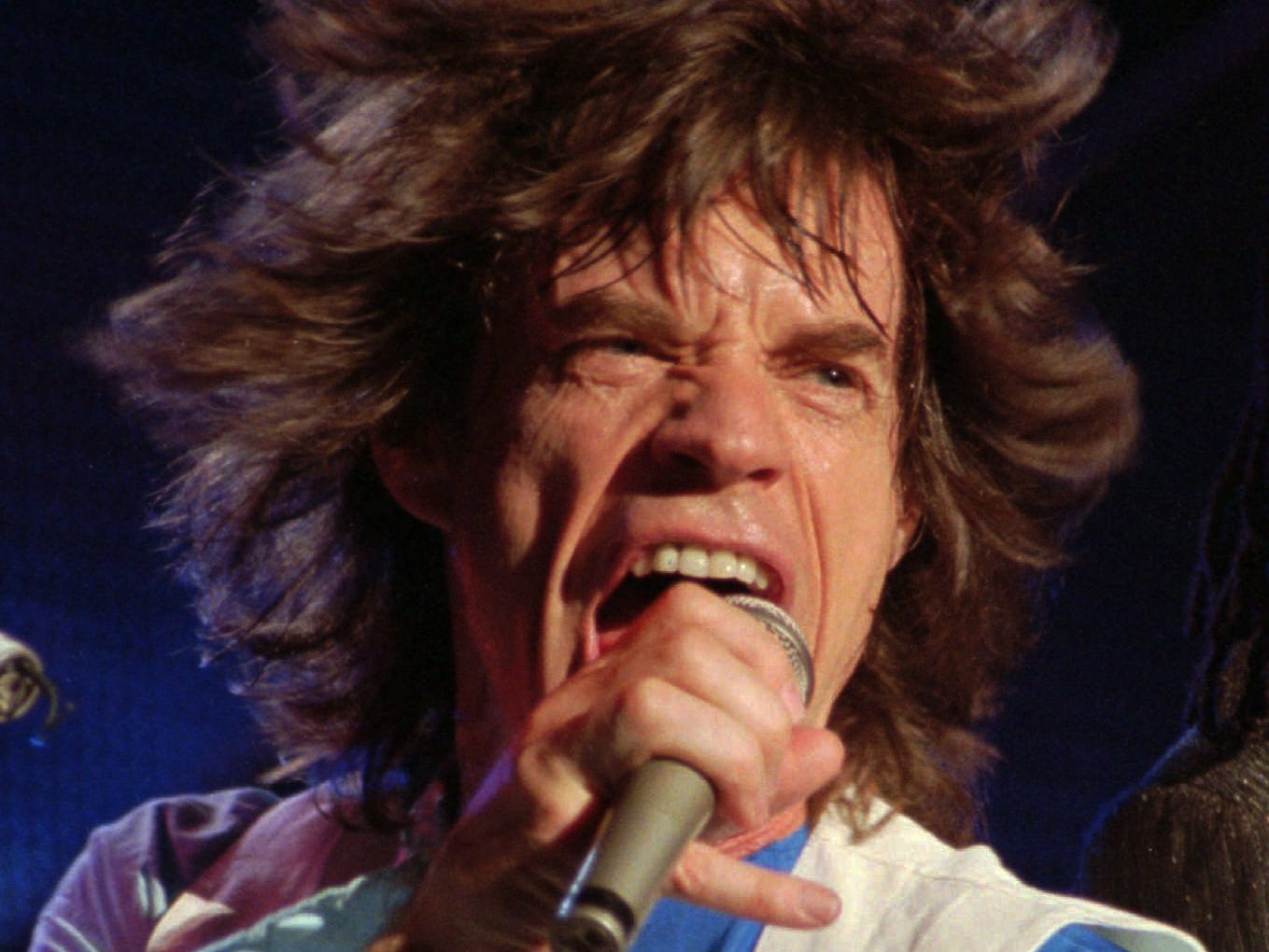 "Rolling Stones lead singer Mick Jagger belts out ""Shattered"" during the group's VooDoo Lounge tour concert Tuesday night Nov. 22, 1994 at Tampa Stadium. (AP Photo/Chris O'Meara) ORG XMIT: TP108"