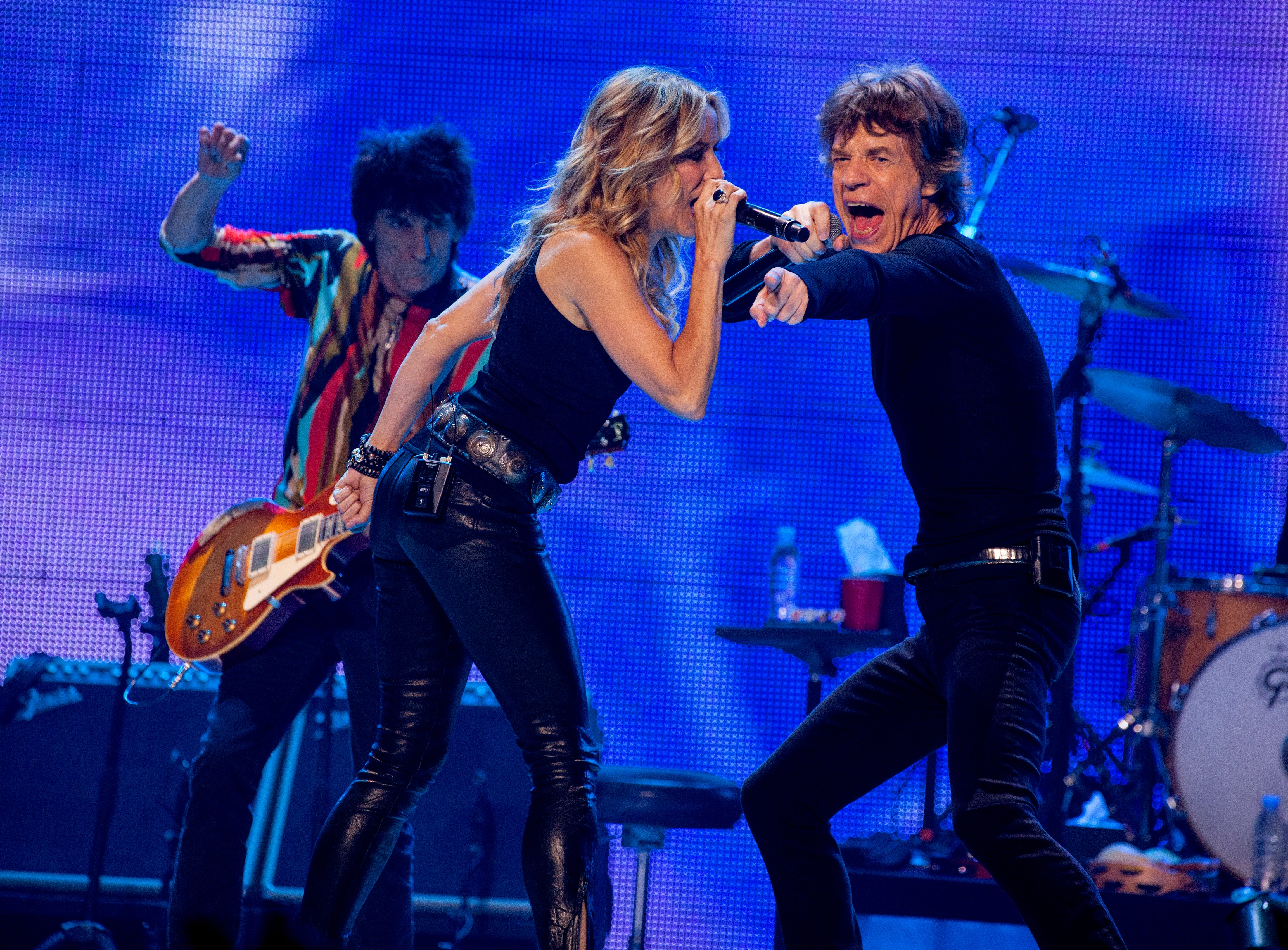 Ronnie Wood of the Rolling Stones with special guest Sheryl Crow and Mick Jagger of the Rolling Stones perform at the United Center on Friday, May 31, 2013 in Chicago. (Photo by Barry Brecheisen/Invision/AP) ORG XMIT: ILBB105