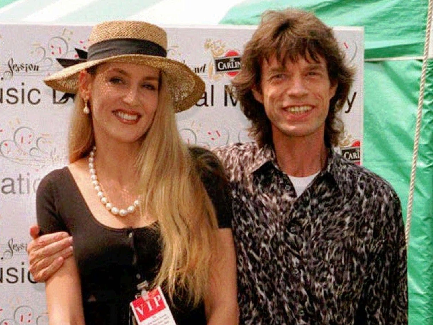 FILE--Rolling Stone singer Mick Jagger and his wife Jerry Hall are shown in this June 28, 1992 file photo.  Jagger and Hall have split again and may divorce, British tabloids agreed Sunday, Nov. 22, 1998.  But the tabs are divided over whether the trouble this time is over Jagger's other women or his anger that their willowy, 14-year-old daughter, Elizabeth, is already following in her mother's footsteps on the catwalk. Texan-born Hall has flown to New York, taking the couple's youngest child, 11-month-old son Gabriel, and plans to seek a divorce settlement through lawyers in the United States, according to the reports. (AP Photo/file) --UNITED KINGDOM OUT-- ORG XMIT: NY44