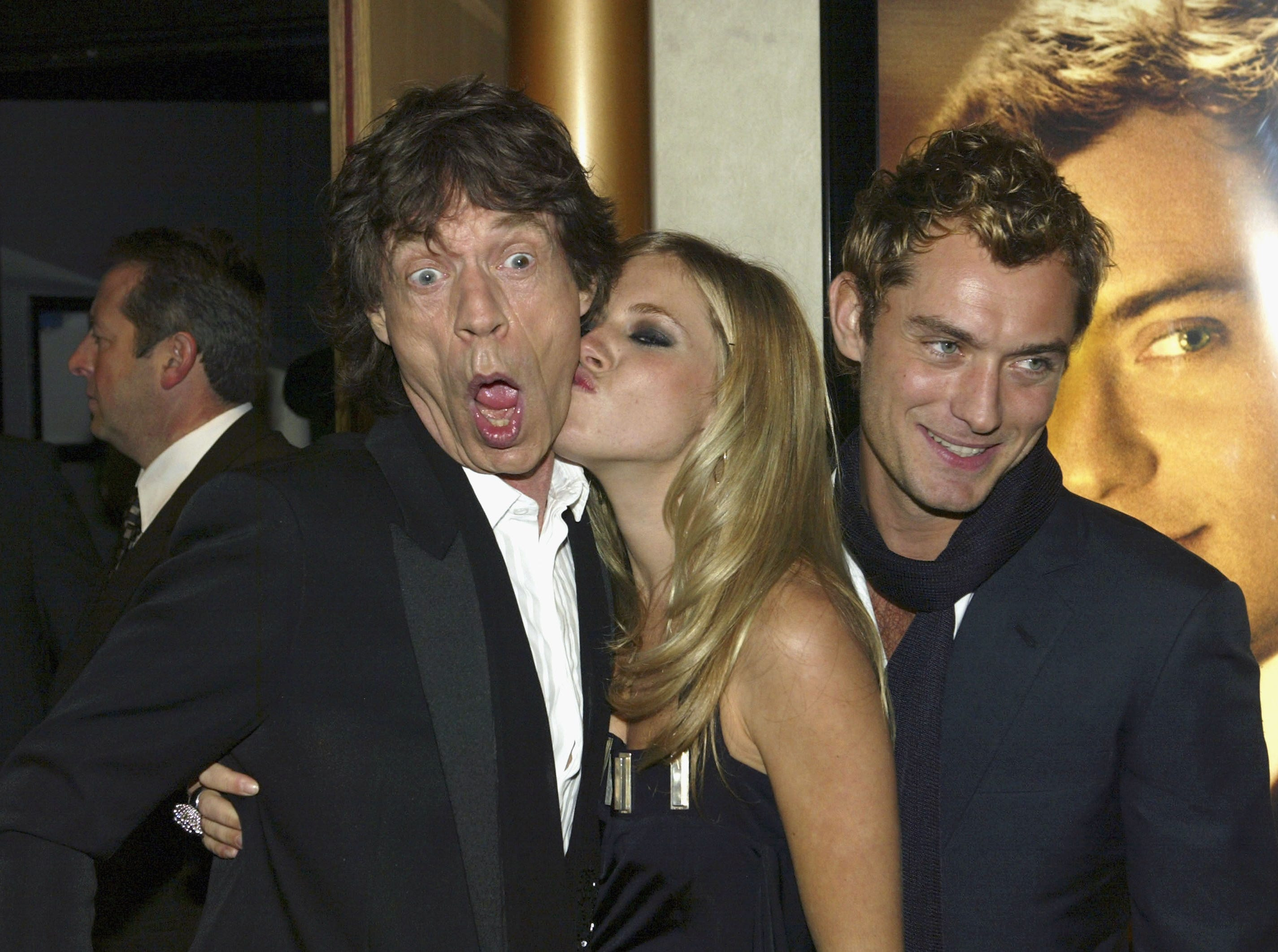 "LONDON -  OCTOBER 14: (UK TABLOID NEWSPAPERS OUT)  Singer Mick Jagger and actors Sienna Miller and Jude Law  arrive at the World Premiere of ""Alfie"" at the Empire Leicester Square on October 14, 2004 in London. (Photo by Dave Hogan/Getty Images) *** Local Caption *** Mick Jagger;Sienna Miller;Jude Law   ORG XMIT: 51442264 GTY ID:  51442264DHN001_alfie"