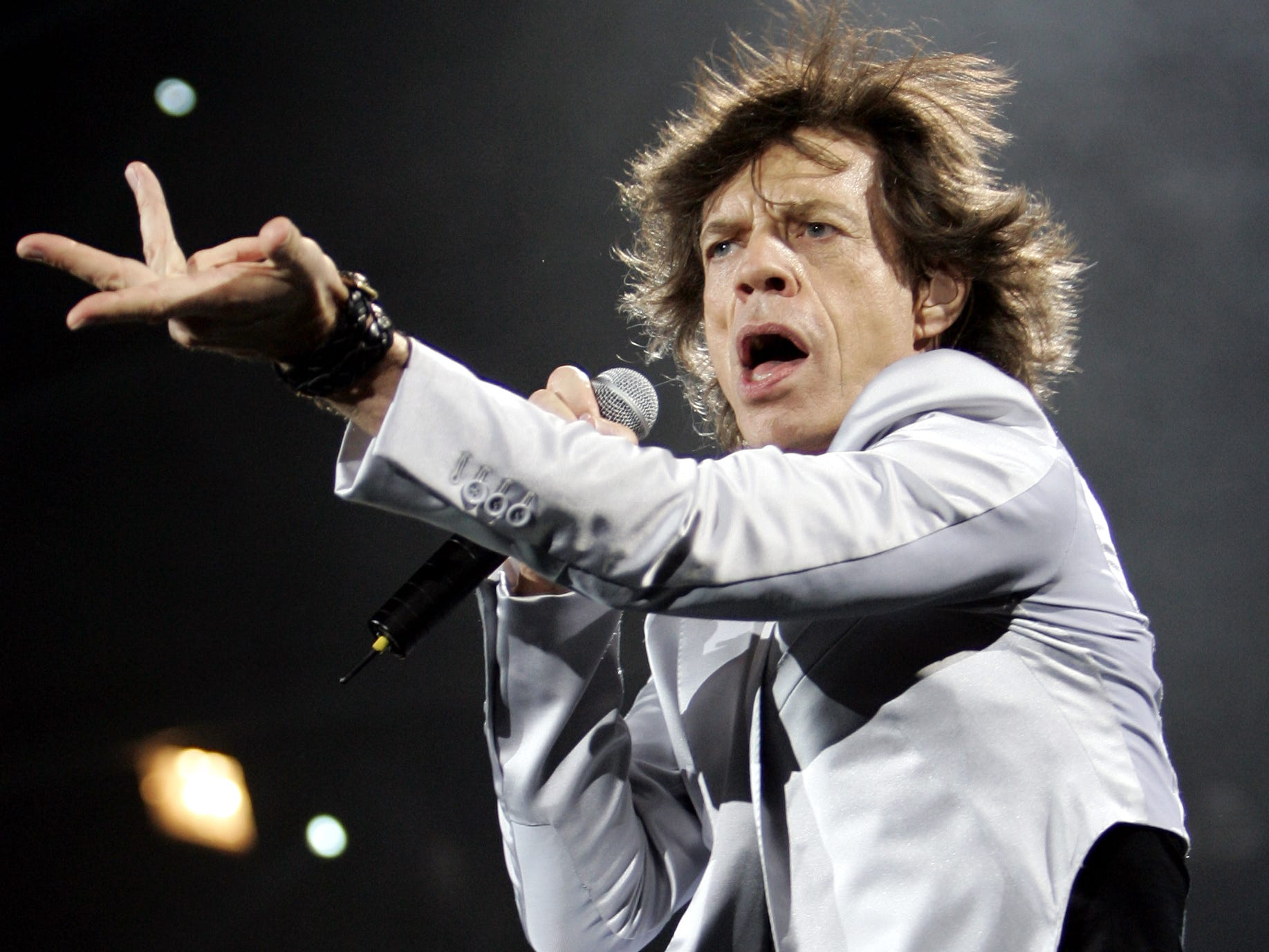Rolling Stones' Mick Jagger performs during the opening night of their U.S. tour in Boston, Tuesday, Sept. 3, 2002. (AP Photo/Winslow Townson)