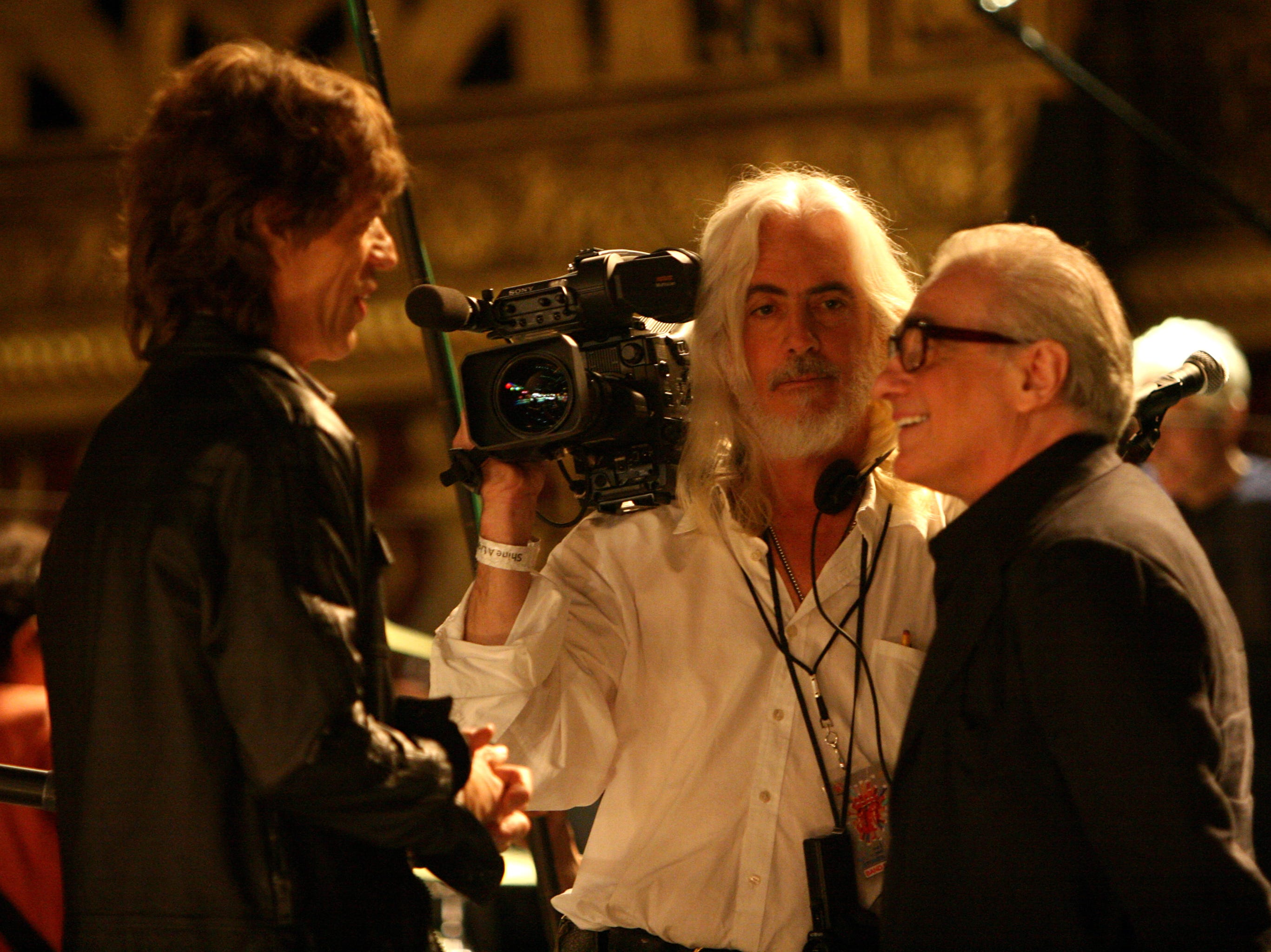 "Left to right: Mick Jagger, director of photography Robert Richardson, and director Martin Scorsese backstage at the Beacon Theater while filming the Rolling Stones concert film ""Shine A Light."" Photo by Jacob Cohl, Paramount Classics (Via MerlinFTP Drop)"